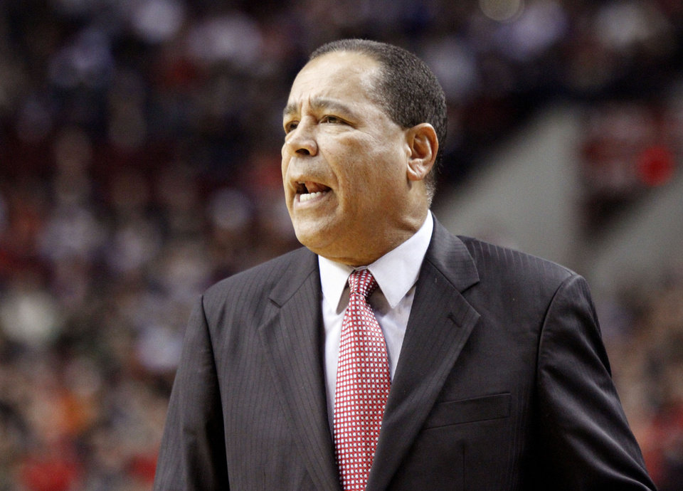 Houston Rockets assistant basketball coach Kelvin Sampson gives direction from the bench during the first half of their NBA basketball game against the Portland Trail Blazers in Portland, Ore., Friday, Nov. 16, 2012. Sampson was filling in for head coach Kevin McHale who is on family leave. (AP Photo/Don Ryan)