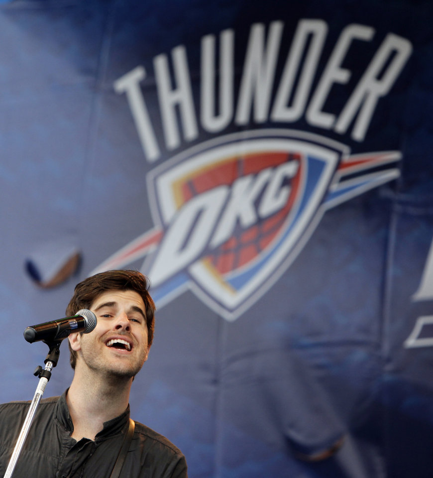 Photo - Graham Colton performs during the Thunder FanFest in Bricktown, celebrating the team making it to the NBA playoffs, in Oklahoma City, Friday, April 16, 2010. Photo by Nate Billings, The Oklahoman