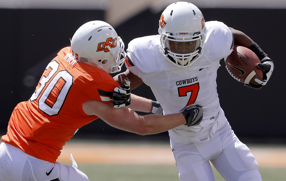 Oklahoma State's Brandon Sheperd tries to get past Bryant Reber during OSU's spring football game at Boone Pickens Stadium in Stillwater, Okla., Sat., April 20, 2013. Photo by Bryan Terry, The Oklahoman