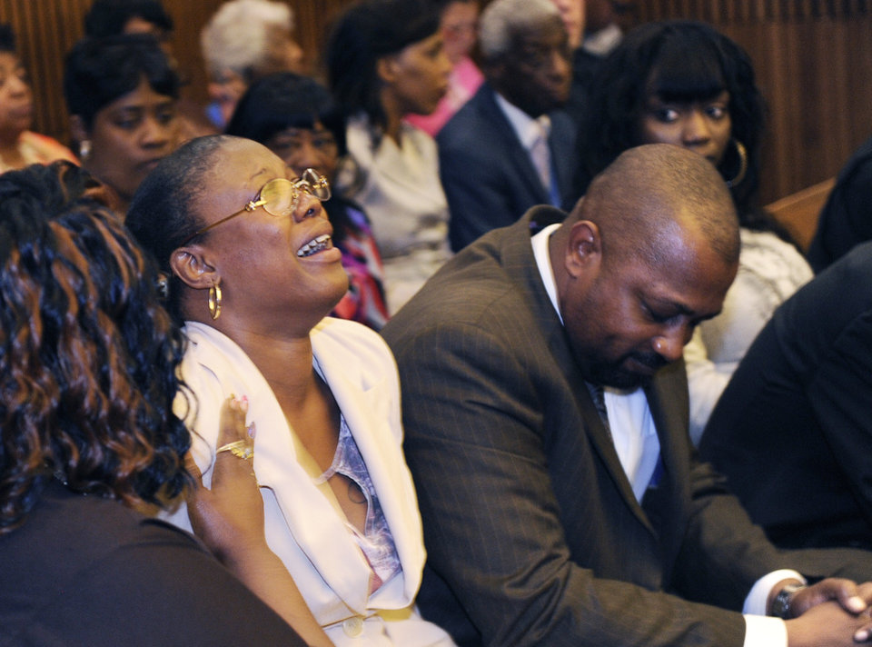 Photo - FILE - In this Aug. 7, 2014 file photo, Monica McBride, mother of Renisha McBride cries during the reading of verdict of guilty of of second-degree murder and manslaughter for Theodore Wafer in Detroit. Walter Ray Simmons, Renisha's father, is at right. Wafer  could come face-to-face with Renisha McBride's parents as he receives his sentence for second-degree murder on Wednesday, Sept. 3, 2014.  (AP Photo/The Detroit News, Clarence Tabb Jr.)