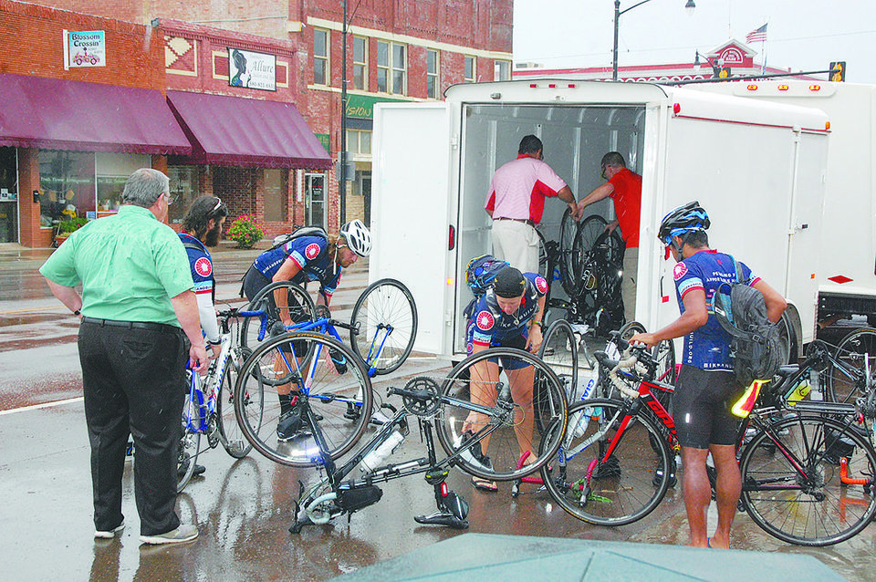 Photo -  Patrick Wanninkhof and his riding partner, Bridget Anderson, were among a group of about 30 cyclists traveling across the country for a nonprofit organization that raises money to build affordable housing.  [PHOTO BY Dayva Spitze, Sayre Record-Democrat]