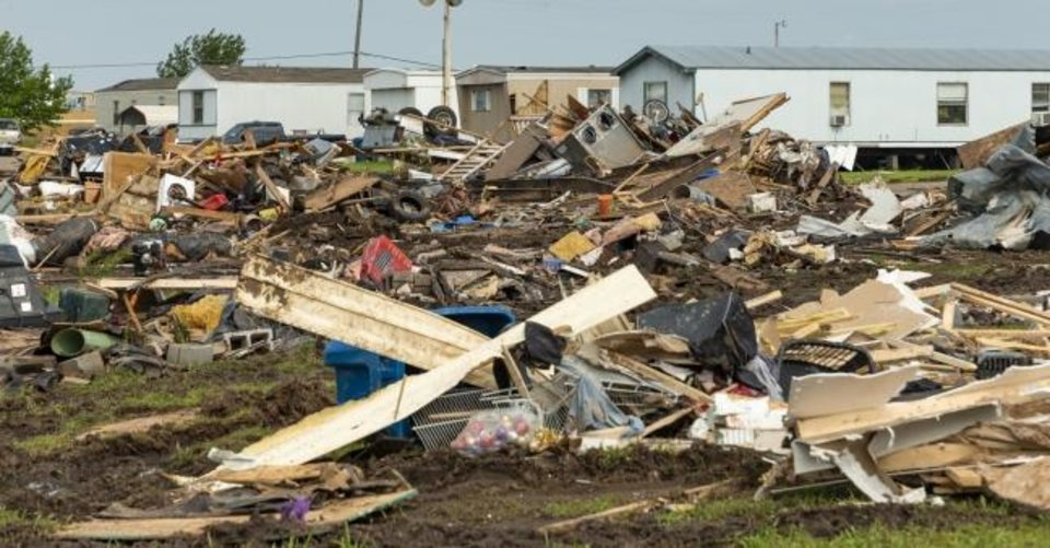 Photo -  Storm damage and debris left behind at the Skyview Mobile Home Park in the aftermath of a tornado in El Reno, Okla. on Monday, May 27, 2019. The EF3 tornado hit the area on Saturday night killing two people and injuring many others. (Chris Landsberger/The Oklahoman,via AP)