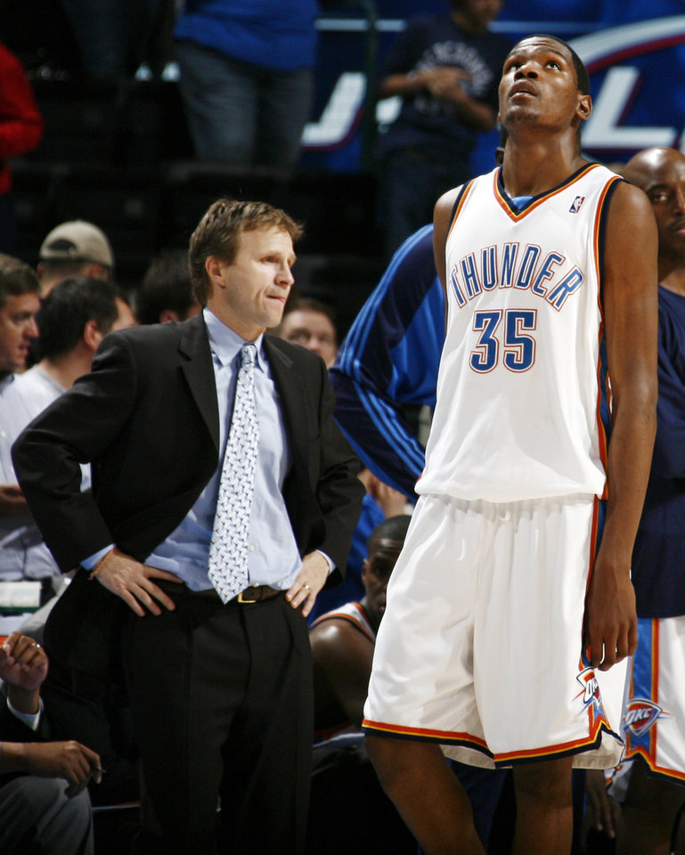 Photo - Oklahoma City's Kevin Durant looks up at the scoreboard late in the fourth quarter as head coach Scott Brooks watches from the bench during the NBA basketball game between the Golden State Warriors and the Oklahoma City Thunder at the Ford Center in Oklahoma City, Monday, December 8, 2008. Golden State won, 112-102.  BY NATE BILLINGS, THE OKLAHOMAN