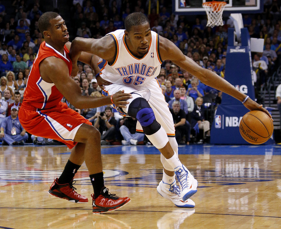 Oklahoma City\'s Kevin Durant (35) tries to get past the Clippers Chris Paul (3) during an NBA basketball game between the Oklahoma City Thunder and the Los Angeles Clippers at Chesapeake Energy Arena in Oklahoma City, Wednesday, Nov. 21, 2012. Photo by Bryan Terry, The Oklahoman