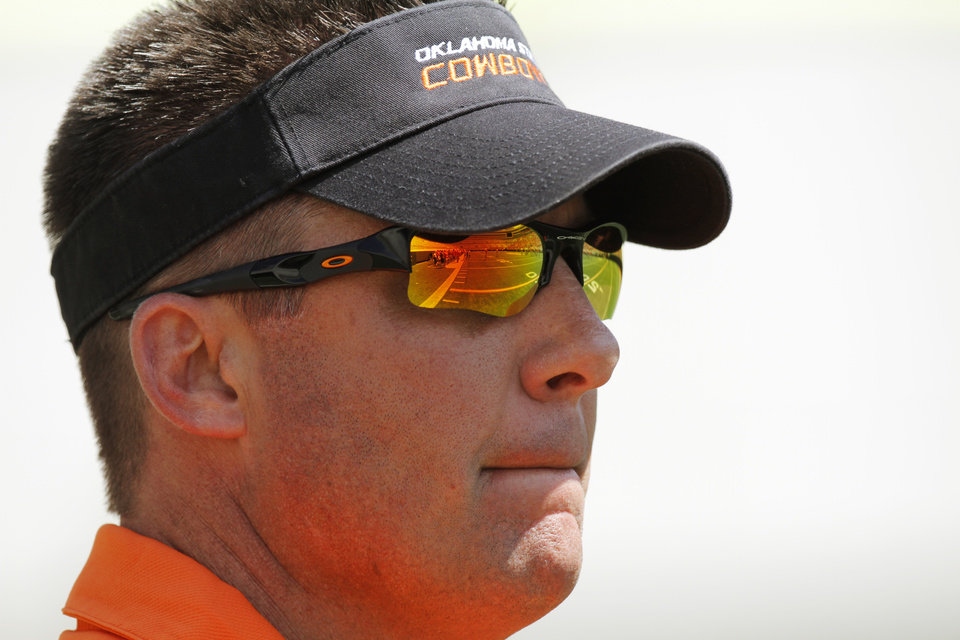 OSU head coach Mike Gundy watches the Orange/White spring football game for the Oklahoma State University Cowboys at Boone Pickens Stadium in Stillwater, Okla., Saturday, April 16, 2011. Photo by Nate Billings, The Oklahoman