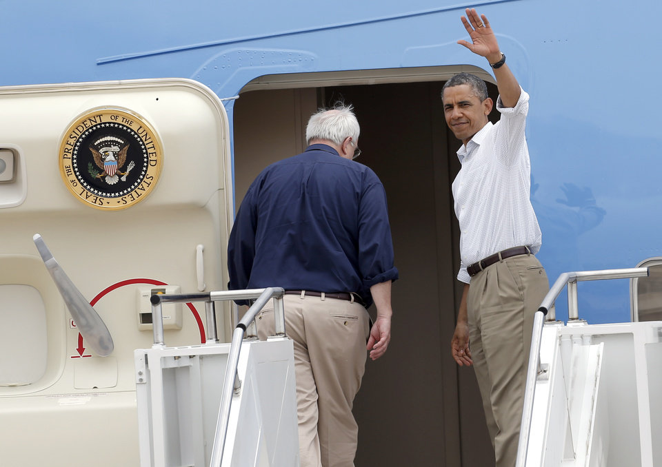 Photo - President Barack Obama waves as he prepares to leave at Tinker Air Force base in Midwest City, Sunday, May 26, 2013. Obama was in town to visit areas damaged by the May 20 tornado. Photo by Sarah Phipps, The Oklahoman