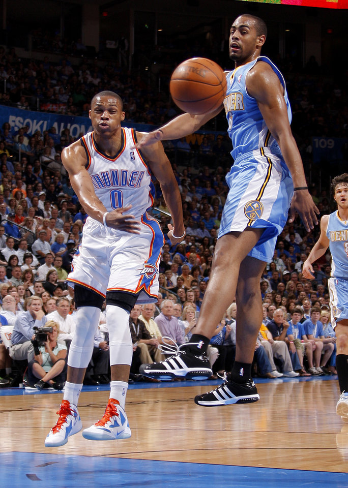 Oklahoma City's Russell Westbrook (0) passes the ball past Denver's Arron Afflalo (6) during the NBA basketball game between the Oklahoma City Thunder and the Denver Nuggets at Chesapeake Energy Arena in Oklahoma City, Wednesday, April 25, 2012. Photo by Bryan Terry, The Oklahoman