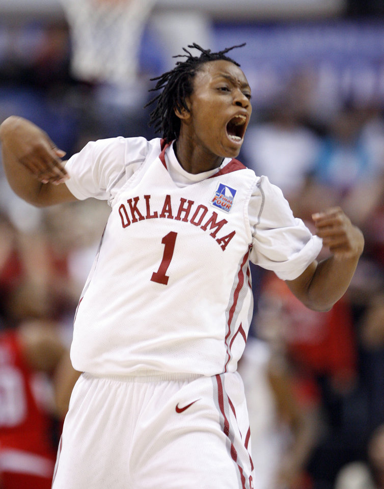 Photo - Nyeshia Stevenson reacts after a score in the opening minutes of the first half as the University of Oklahoma plays Louisville at the 2009 NCAA women's basketball tournament Final Four in the Scottrade Center in Saint Louis, Missouri on Sunday, April 5, 2009. Photo by Steve Sisney, The Oklahoman