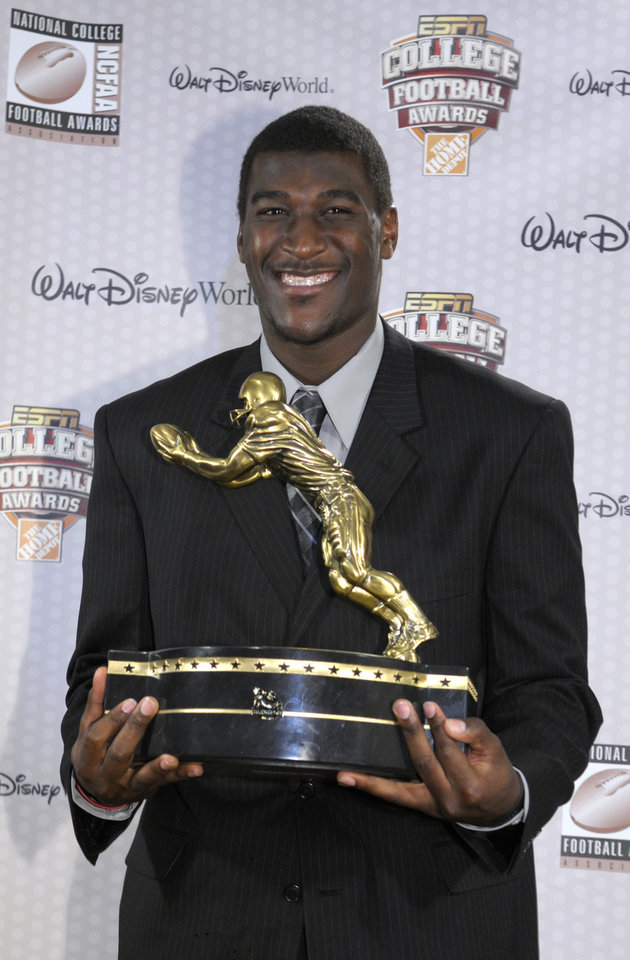 Photo - Oklahoma State wide receiver Justin Blackmon poses with the Biletnikoff Award trophy given to the best college receiver at the Home Depot ESPNU College Football Awards in Lake Buena Vista, Fla., Thursday, Dec. 9, 2010. (AP Photo/Phelan M. Ebenhack)