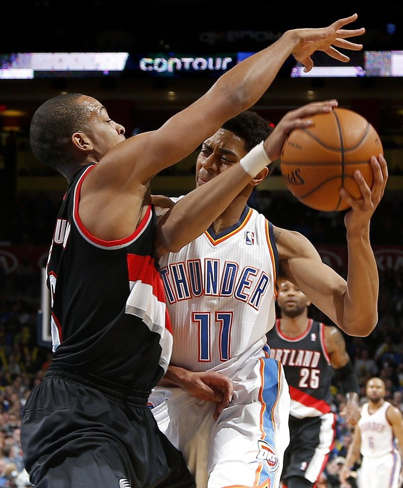 Photo - Oklahoma City's Jeremy Lamb (11) tries to get past Portland's C.J. McCollum (3) during an NBA basketball game between the Oklahoma City Thunder and the Portland Trail Blazers at Chesapeake Energy Arena in Oklahoma City, Tuesday, Jan. 21, 2014. Oklahoma City won 105-97. Photo by Bryan Terry, The Oklahoman