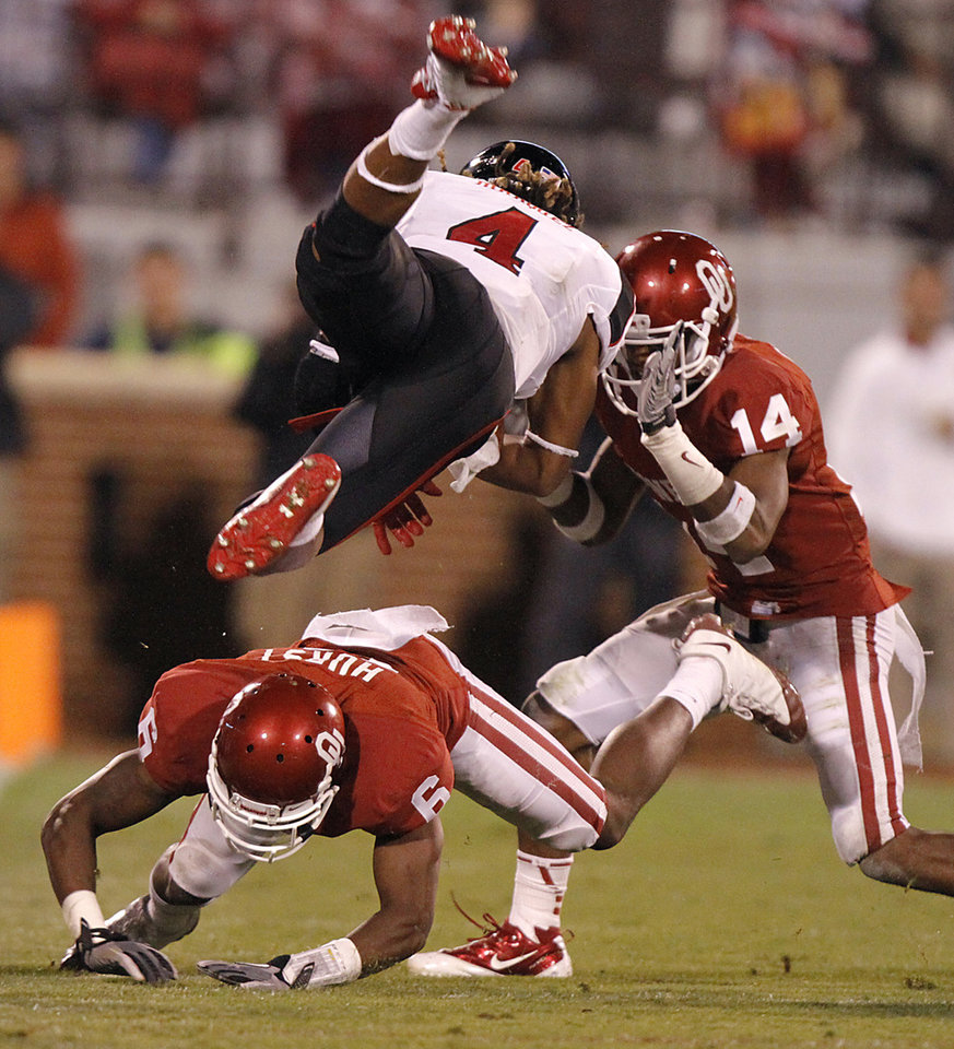 Photo - Oklahoma's Demontre Hurst (6) and Aaron Colvin (14) stop Texas Tech's Bradley Marquez (4) during the college football game between the University of Oklahoma Sooners (OU) and Texas Tech University Red Raiders (TTU) at the Gaylord Family-Oklahoma Memorial Stadium on Saturday, Oct. 22, 2011. in Norman, Okla. Photo by Chris Landsberger, The Oklahoman