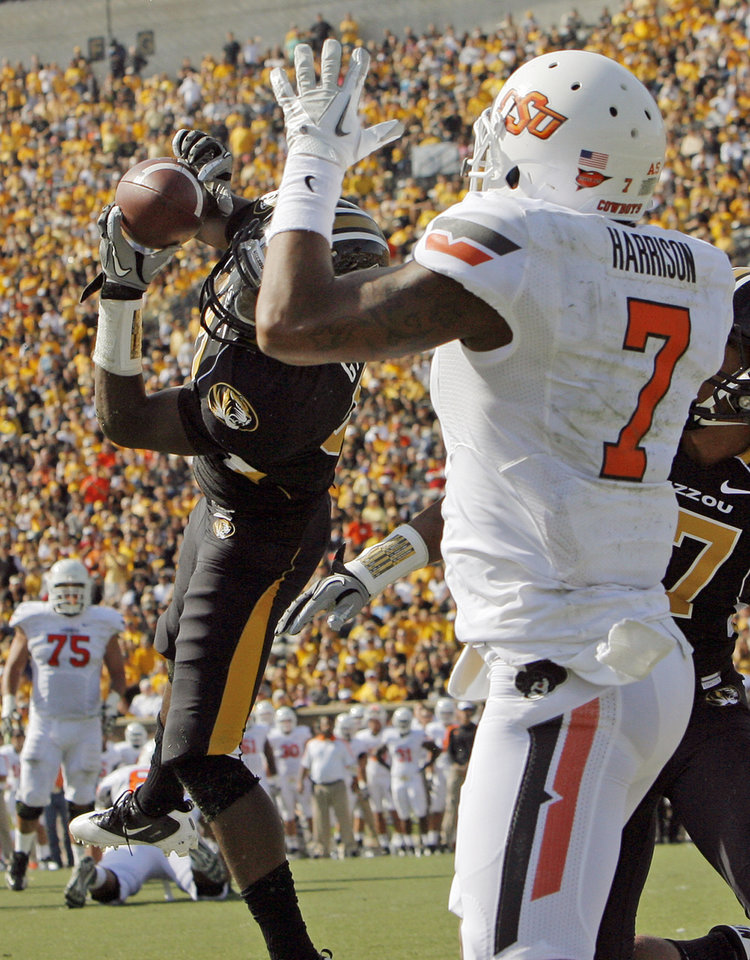 Photo - Missouri's E.J. Gaines (31) intercepts a pass intended for Oklahoma State's Michael Harrison (7) in the end zone during the third quarter of a college football game between the Oklahoma State University Cowboys (OSU) and the University of Missouri Tigers (Mizzou) at Faurot Field in Columbia, Mo.,  OSU won, 45-24. Saturday, Oct. 22, 2011. Photo by Nate Billings, The Oklahoman