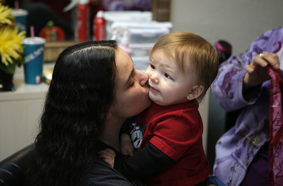 Miranda Marshall kisses her son, Nathan, who is the sixth generation of a family that has been seeing Vona Hankins for haircuts in Oklahoma City, Friday, Nov. 16, 2012.  Photo by Garett Fisbeck, The Oklahoman
