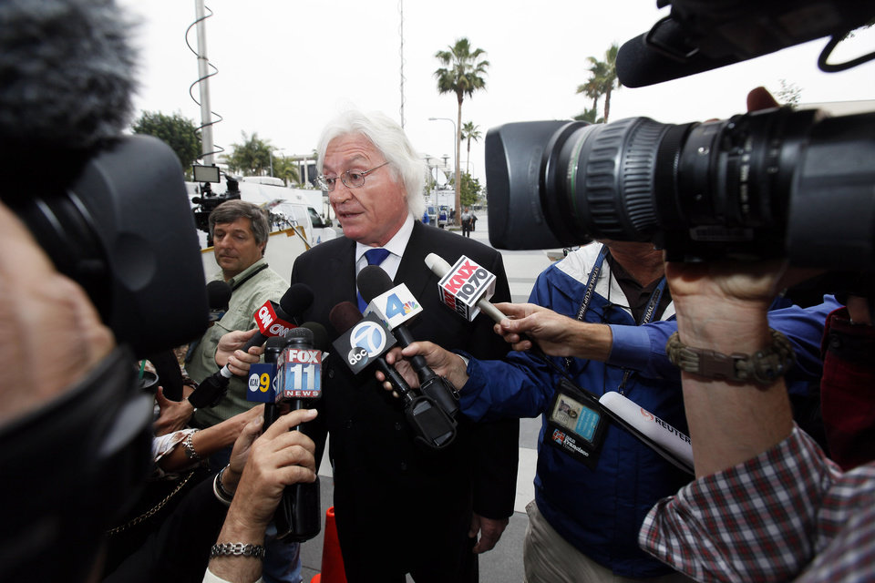 Photo - Former Michael Jackson's attorney Thomas Mesereau talks to reporters as he arrives at a courthouse for Katherine Jackson's lawsuit against concert giant AEG Live in Los Angeles, Monday, April 29, 2013. Mesereau is expected to testify during the trial. (AP Photo/Nick Ut)