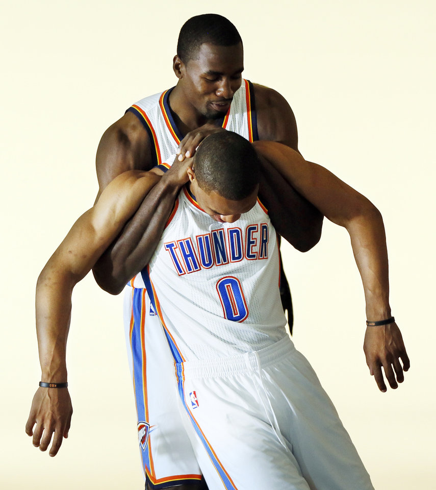 Photo - ALTERNATE CROP: Serge Ibaka, back, jokes around with Russell Westbrook during media day for the Oklahoma City Thunder NBA basketball team at the Thunder Events Center in Oklahoma City, Monday, Oct. 1, 2012.  Photo by Nate Billings, The Oklahoman