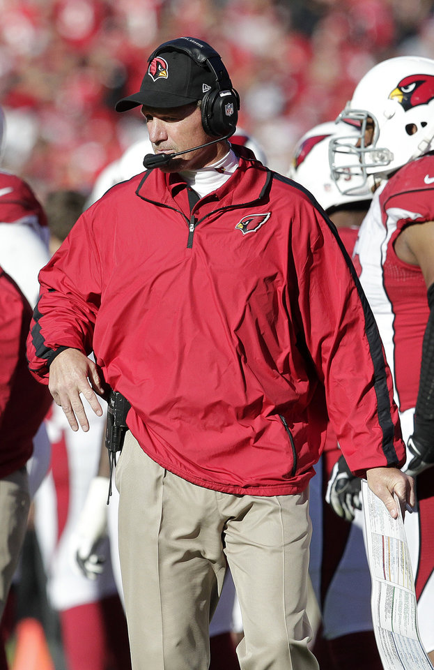 Photo - Arizona Cardinals head coach Ken Whisenhunt stands on the sideline during the second quarter of an NFL football game against the San Francisco 49ers in San Francisco, Sunday, Dec. 30, 2012. (AP Photo/Tony Avelar)