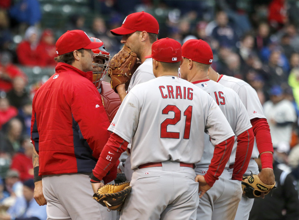 Photo - during the St. Louis Cardinals manager Mike Matheny, left, talks with starting pitcher Adam Wainwright and the complete infield during the fifth inning of a baseball game on Friday, May 2, 2014, in Chicago. (AP Photo/Charles Rex Arbogast)