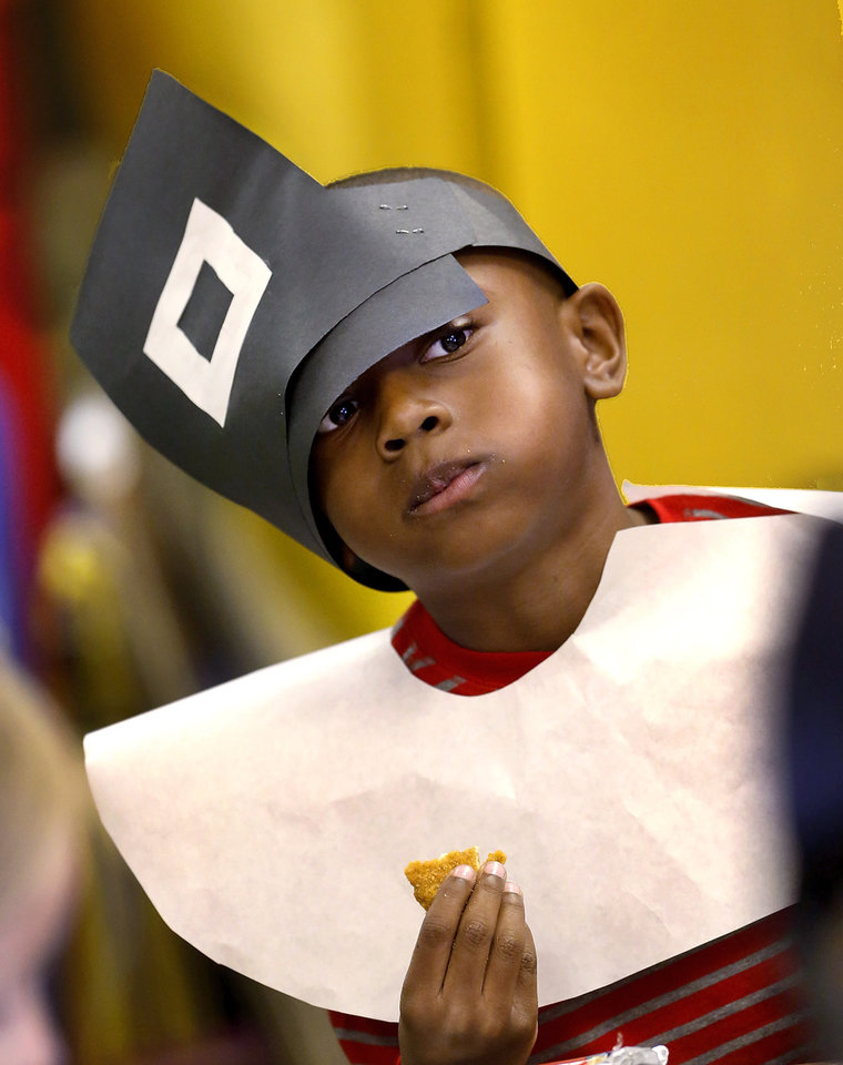 Trystan Haynes' pilgrim hat wouldn't remain upright on his head while he enjoyed his Thanksgiving food in Kristin Rusler classroom during the Thanksgiving celebration, Kindergarten students in Soldier Creek Elementary School in Midwest City dressed as pilgrims and Indians as they celebrated a Thanksgiving meal in their classrooms on Tuesday,  Nov. 20, 2012.   Photo by Jim Beckel, The Oklahoman