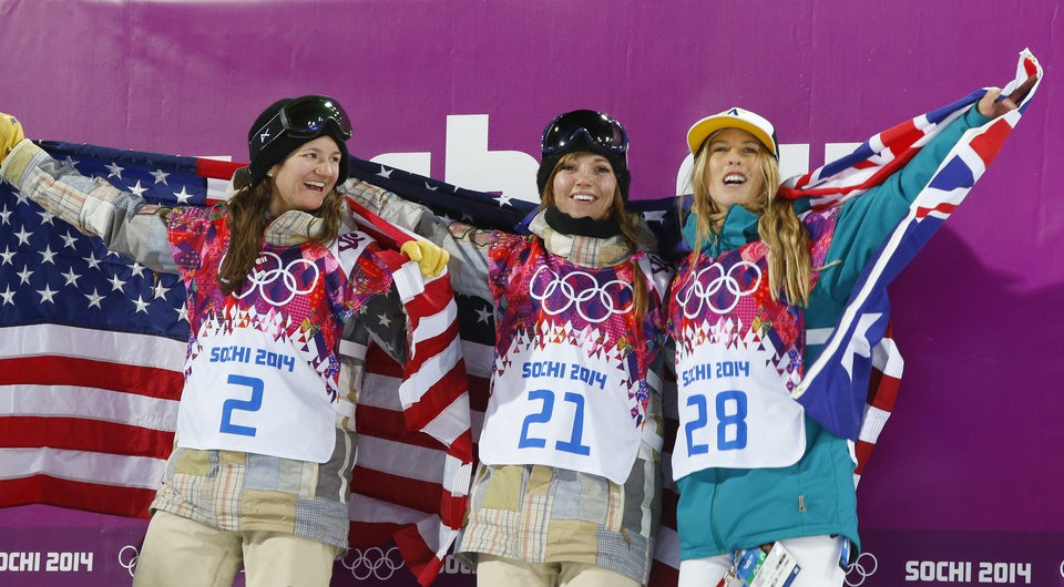 Photo - From left, bronze medalist United States' Kelly Clark, gold medalist United States' Kaitlyn Farrington and silver medalist Australia's Torah Bright pose following the women's snowboard halfpipe at the Rosa Khutor Extreme Park, at the 2014 Winter Olympics, Wednesday, Feb. 12, 2014, in Krasnaya Polyana, Russia. (AP Photo/Sergei Grits)
