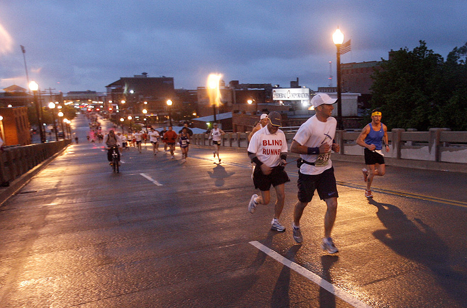 Matt Guidry guides blind runner, Kerry Cook, up the Walnut Street bridge during the 8th annual Oklahoma City Memorial Marathon on Sunday, April 27, 2008, in Oklahoma City, Okla.