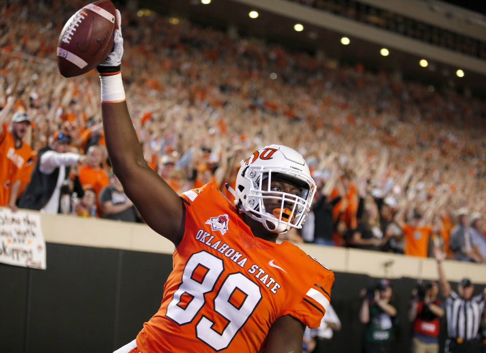 Photo - Oklahoma State's Jelani Woods (89) celebrates a touchdown in the first quarter during a college football game between Oklahoma State (OSU) and University of Texas a at Boone Pickens Stadium in Stillwater, Okla., Saturday, Oct. 27, 2018. Photo by Sarah Phipps, The Oklahoman