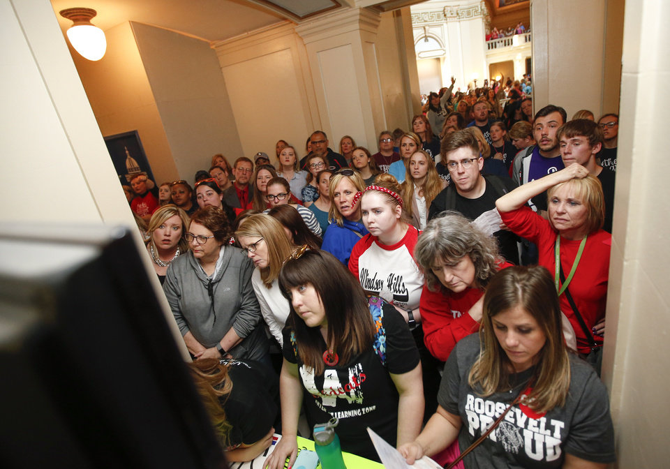 Photo - Teachers, students and supporters of increased education funding watch a closed circuit feed of the House of Representatives outside the entrance to the House chamber on the fourth floor of the state Capitol during the third day of a walkout by Oklahoma teachers, in Oklahoma City, Wednesday, April 4, 2018. Photo by Nate Billings, The Oklahoman