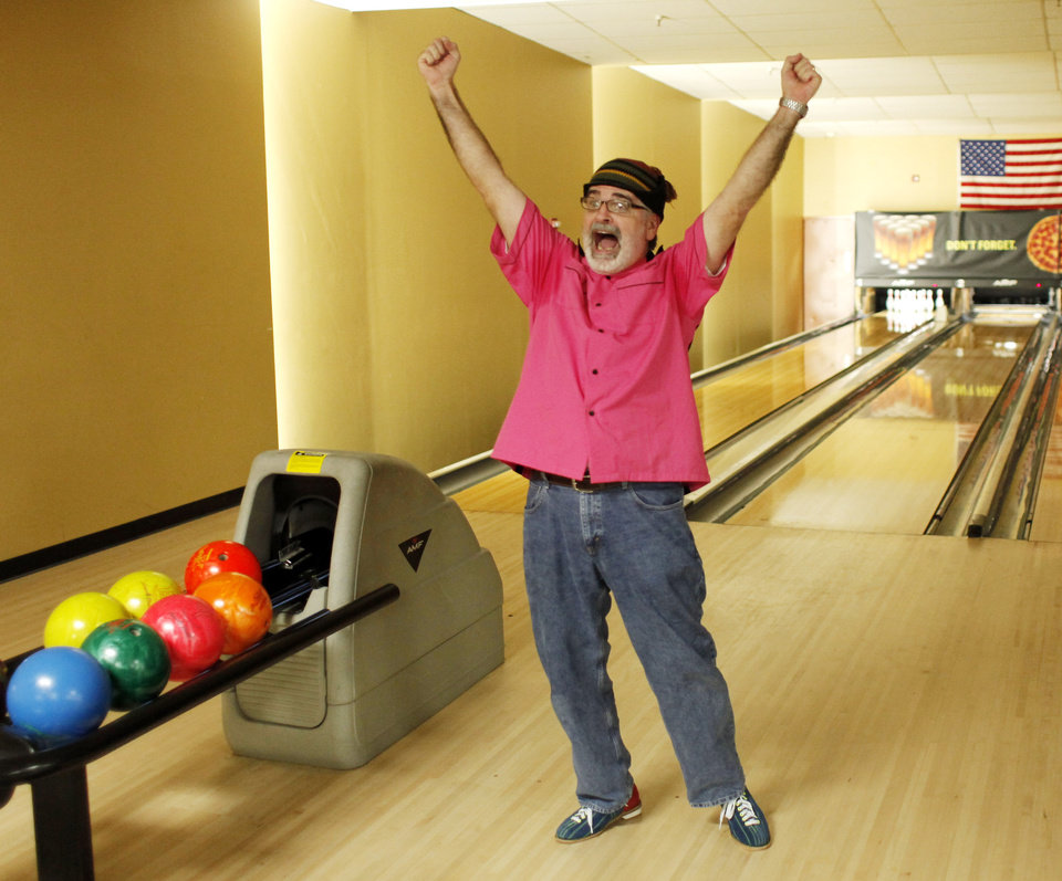 Chris H. Palmer, with team Mad Hats, celebrates a strike during the Big Brothers Big Sisters of Oklahoma bowling fundraiser at Boulevard Bowl in Edmond Saturday, March, Mar. 12, 2011. Photo by Doug Hoke, The Oklahoman.