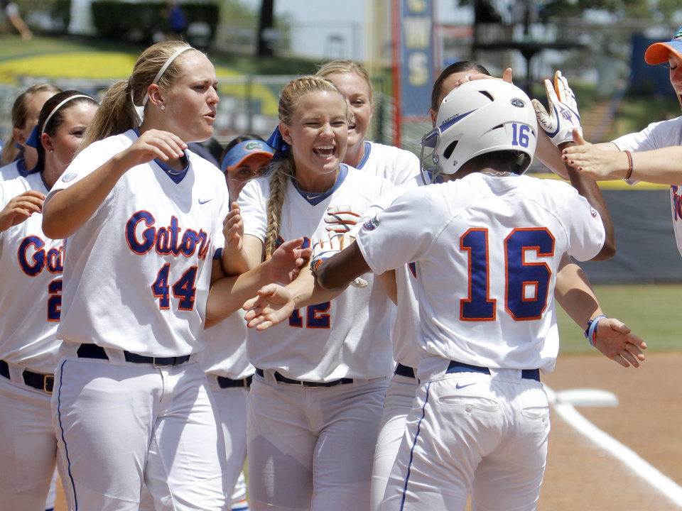 Photo - Florida celebrates Florida's Michelle Moultrie (16) home run during the Women's College World Series game between Florida and Alabama at the ASA Hall of Fame Stadium in Oklahoma City, Sunday, June 5, 2011. Photo by Sarah Phipps, The Oklahoman