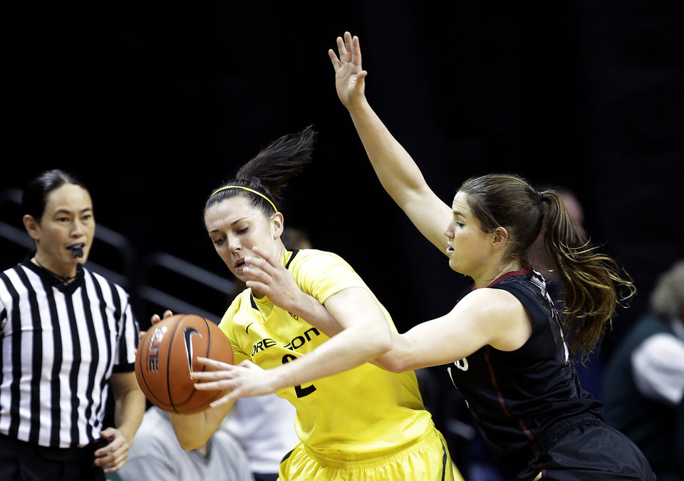 Stanford guard Sara James, right, plays tight defense on Oregon forward Danielle Love during the first half of an NCAA college basketball game in Eugene, Ore., Friday, Feb. 1, 2013. (AP Photo/Don Ryan)