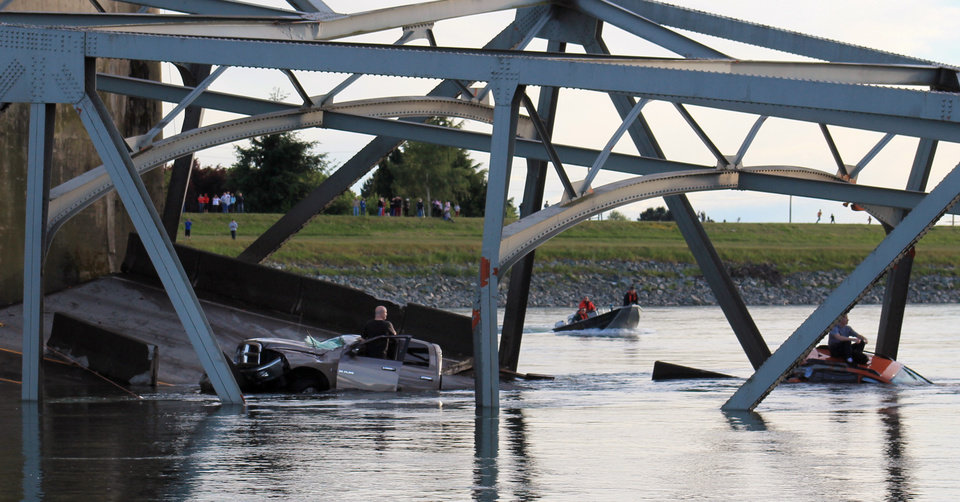 Photo - In this photo provided by Francisco Rodriguez, a rescue boat approaches the scene where a pickup truck and a car fell into the Skagit River after the collapse of the Interstate 5 bridgeThursday, May 23, 2013, in Mount Vernon, Wash. (AP Photo/Francisco Rodriguez)
