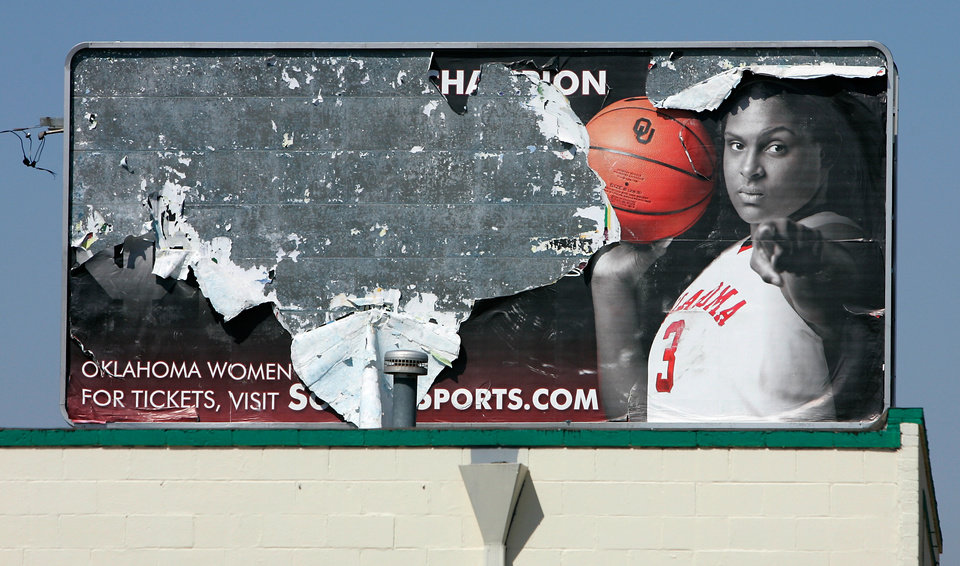 This weathered Courtney Paris billboard is located near 9th and Classen in Oklahoma City, Okla. March.11 , 2008.  BY STEVE GOOCH, THE  OKLAHOMAN.