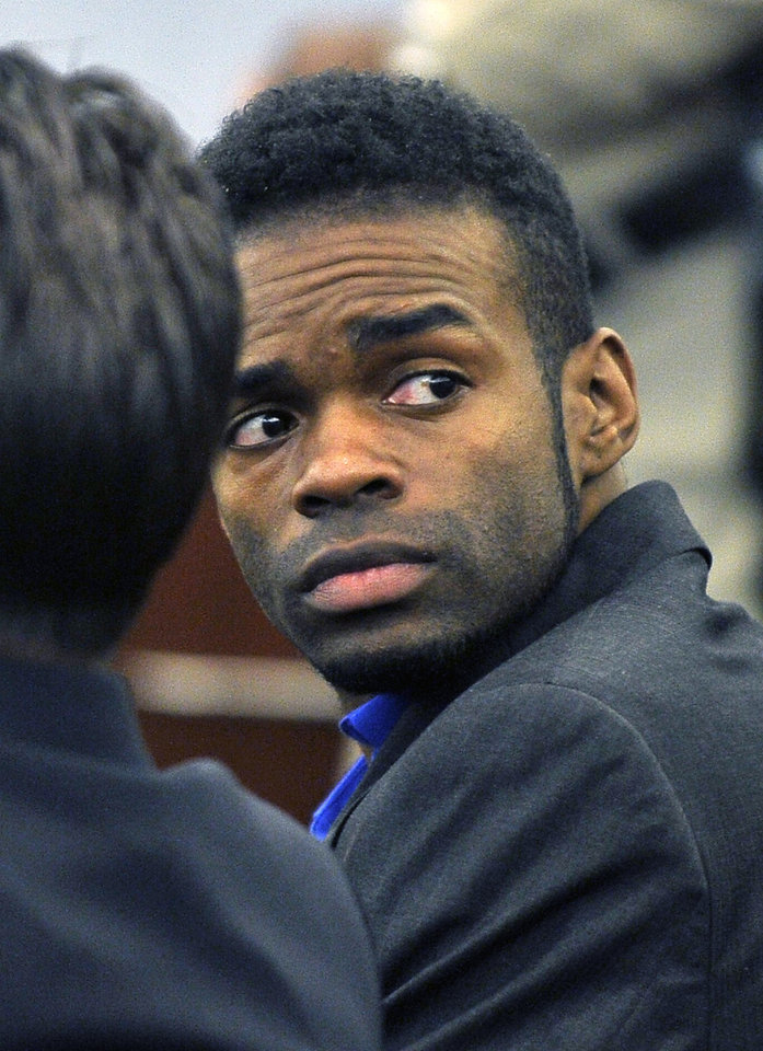 Photo - Jason Omar Griffith, looks on after a guilty verdict was read during his murder trial at the Regional Justice Center on Thursday, May 22, 2014, in Las Vegas. Griffith was convicted of second degree murder of his girlfriend and Luxor