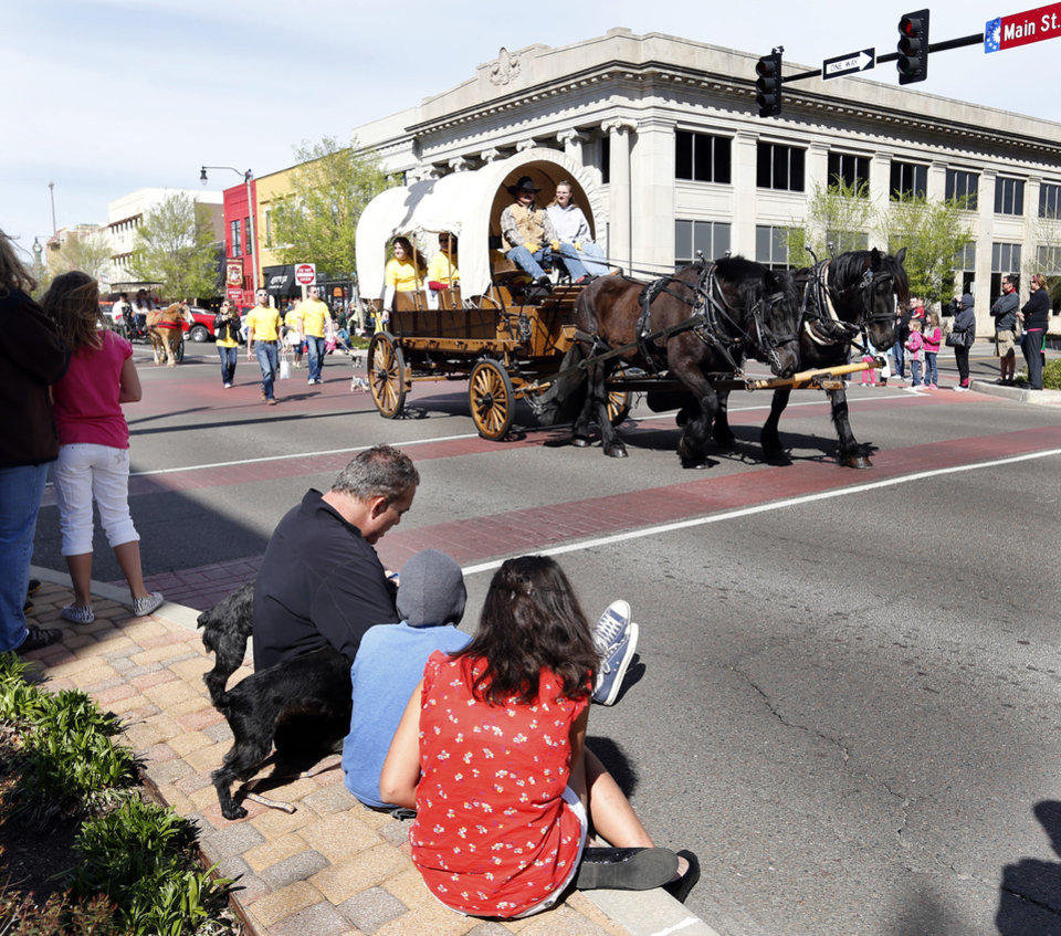 Covered Wagons are seen on Main Street during the 89er Day Parade on Saturday, April 20, 2013 in Norman, Okla.  Photo by Steve Sisney, The Oklahoman