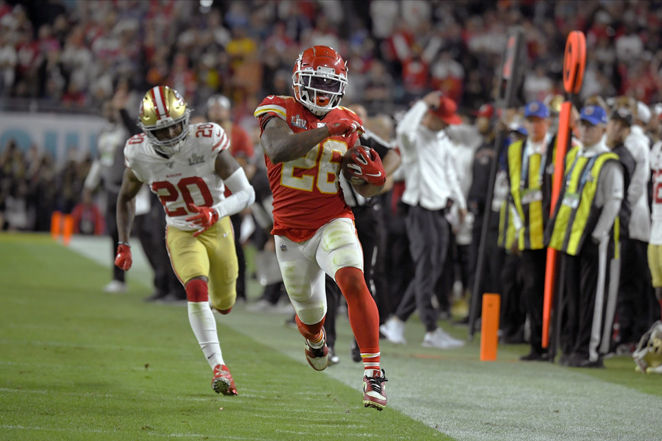 Photo - Kansas City Chiefs' Damien Williams, right, runs away from San Francisco 49ers' Jimmie Ward on his way to the winning touchdown during the second half of the NFL Super Bowl 54 football game Sunday, Feb. 2, 2020, in Miami Gardens, Fla. (AP Photo/Mark J. Terrill)