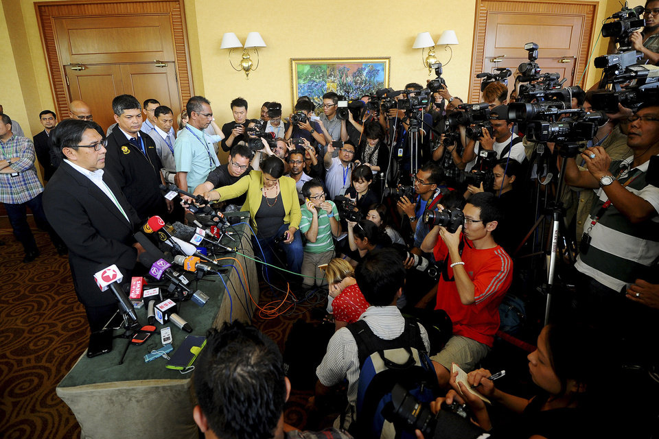 Photo - Malaysia's civil aviation chief Azharuddin Abdul Rahman, left, speaks during a press conference after a close door meeting with Chinese relatives of the passengers onboard the missing Malaysia Airlines Flight 370 at a hotel in Bangi, on the outskirts of Kuala Lumpur, Malaysia, Wednesday, April 2, 2014. The plane disappeared March 8 on a flight to Beijing from Kuala Lumpur after its transponders, which make the plane visible to commercial radar, were shut off. A multinational team of aircraft and ships are searching the southern Indian Ocean for the plane, but have yet to find any sign of the Boeing 777. (AP Photo/Joshua Paul)