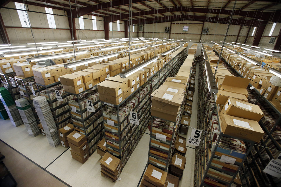 Photo - A view of the thousands of records at the Oklahoma Department of Corrections Closed Records Unit in the Kate Barnard Community Corrections Center in Oklahoma City, Wednesday, May 4, 2016. The Closed Records Unit is currently in a gym and lacks the space needed to store all the records of former inmates. Photo by Nate Billings, The Oklahoman