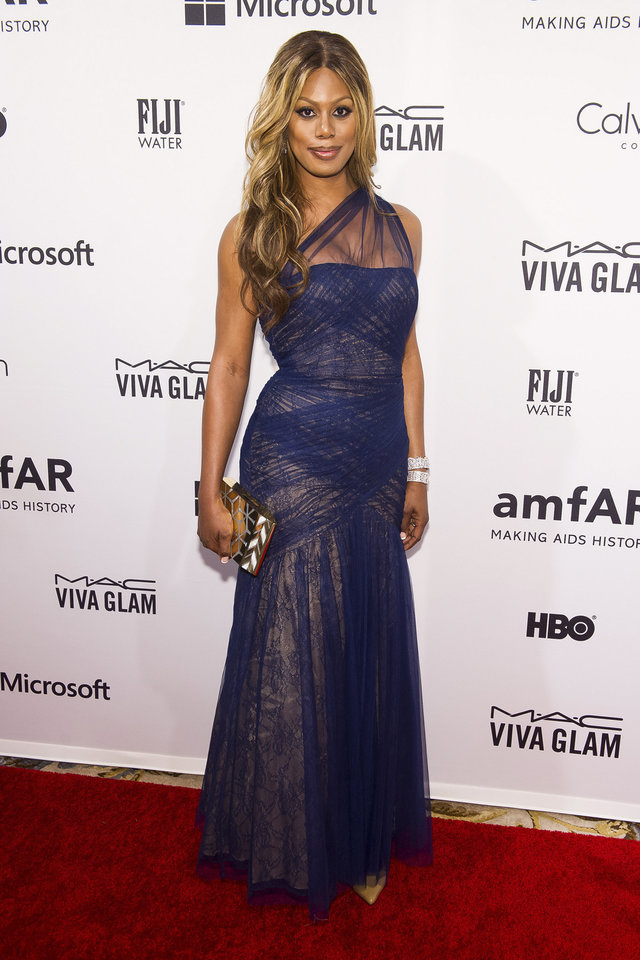 Photo - FILE - This June 10, 2014 file photo shows transgender actress Laverne Cox at amfAR's fifth annual Inspiration Gala in New York. Online retailers catering to masculine presenters have proliferated as trans people have enjoyed a higher profile in the media thanks to Laverne Cox of
