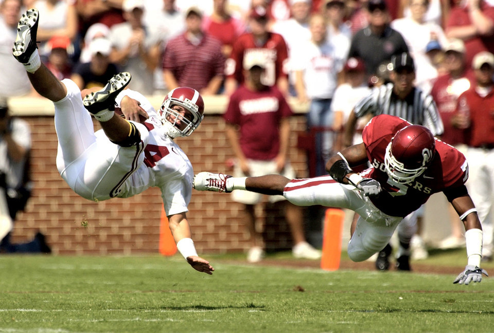 OU: University of Oklahoma college football against Alabama, Sat. Sept. 7, 2002, at Oklahoma Memorial Stadium in Norman, Okla. Brandon Everage flies through the air after hitting quarterback Tyler Watts of Alabama.  Staff photo by Bryan Terry
