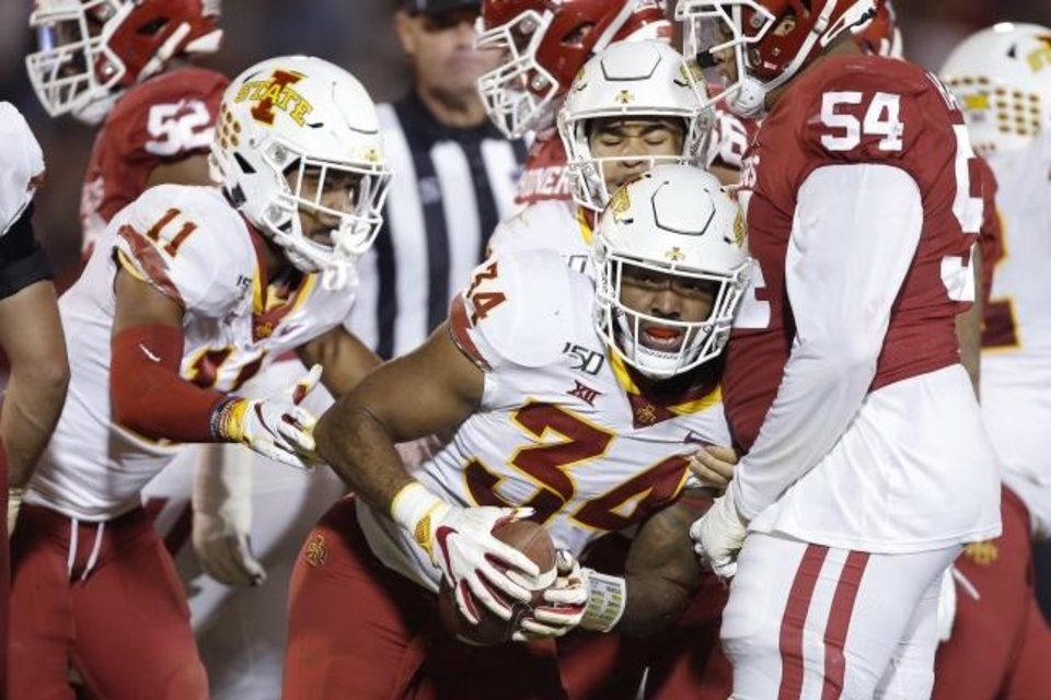 Photo -  Iowa State's O'Rien Vance (34) celebrates after recovering an Oklahoma fumble Saturday night at Owen Field. OU won 42-41 after struggling to hold off the Cyclones' second-half charge. [Bryan Terry/The Oklahoman]