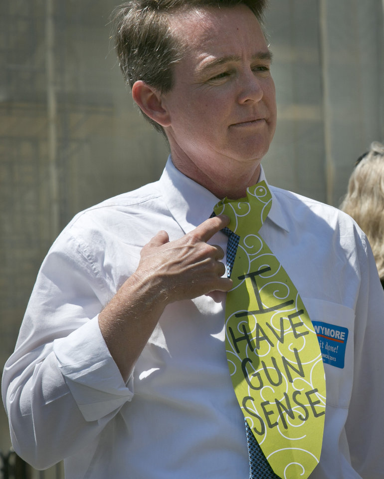 "City council candidate Mel Wymore wears a neck-tie cut out with the words ""I have gun sense,"" during a gun law rally on Friday, June 14, 2013 on the steps of New York City Hall. If Wymore wins a council seat it would mark the first transgender officeholder for the city.  (AP Photo/Bebeto Matthews)"