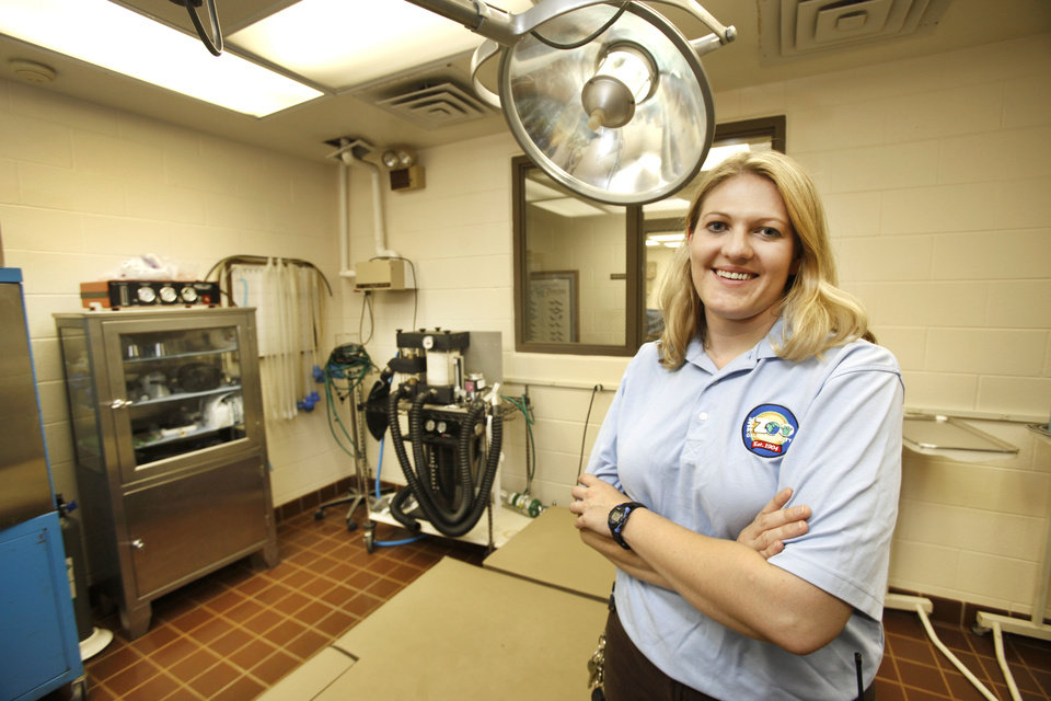 Photo - Oklahoma City Zoo associate veterinarian Gretchen Cole stands in the surgery suite of the zoo's hospital. The zoo has outgrown its current facility and has plans for a new medical center.  Photo By Steve Gooch, The Oklahoman