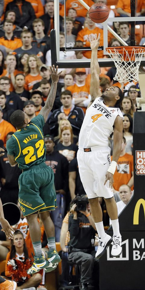 Oklahoma State\'s Brian Williams (4) tries to block the shot of Baylor\'s A.J. Walton (22) during the college basketball game between the Oklahoma State University Cowboys (OSU) and the Baylor University Bears (BU) at Gallagher-Iba Arena on Wednesday, Feb. 5, 2013, in Stillwater, Okla. Photo by Chris Landsberger, The Oklahoman