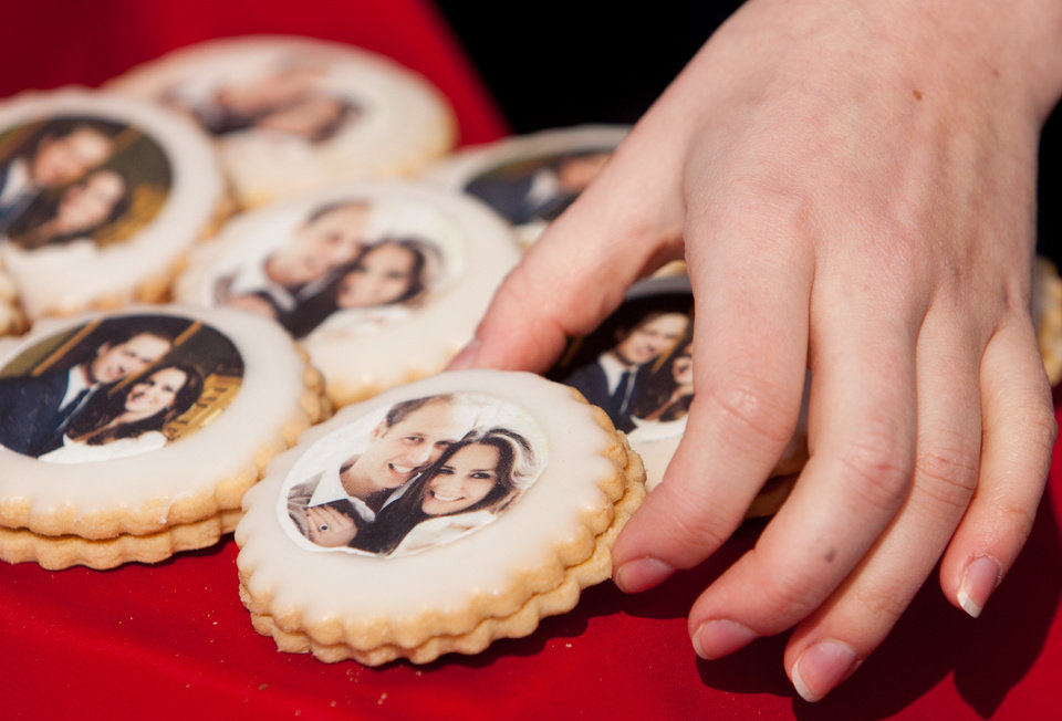 Photo - Biscuits with a picture of Britain's Prince William and Kate Middleton are seen on sale in the grounds of St Andrews University, where students gathered to watch their wedding on a large screen in the grounds of the University, Scotland, Friday, April 29, 2011. (AP Photo/Chris Clark) ORG XMIT: GCC115