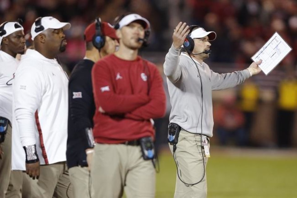 Photo -  Oklahoma head coach Lincoln Riley, center, and defensive coordinator Alex Grinch, right, watch the action between the Sooners and Iowa State on Saturday at Owen Field. OU let a big lead slip away in the fourth quarter and edged the Cyclones, 42-41. [Bryan Terry/The Oklahoman]
