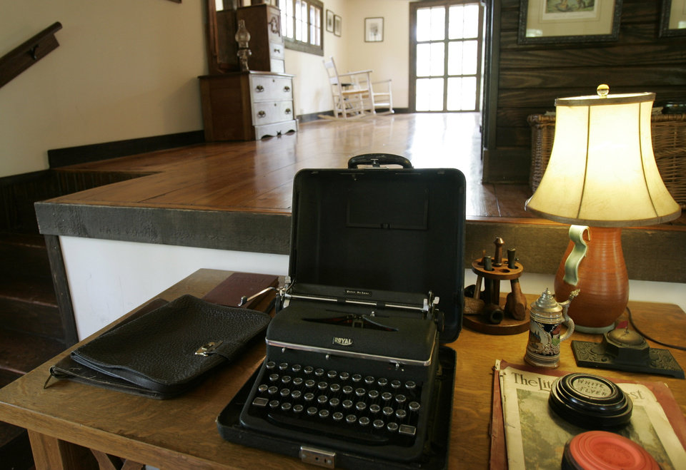 Photo - FILE - This June 18, 2009 file photo shows a 1930s era typewriter on a desk in the loft of a converted barn once used as a studio by author Ernest Hemingway on his then inlaws' property in Piggott, Ark. There are sites connected to Hemingway in many different locales including Florida, Cuba, Arkansas, Idaho and Illinois. (AP Photo/Danny Johnston, File)
