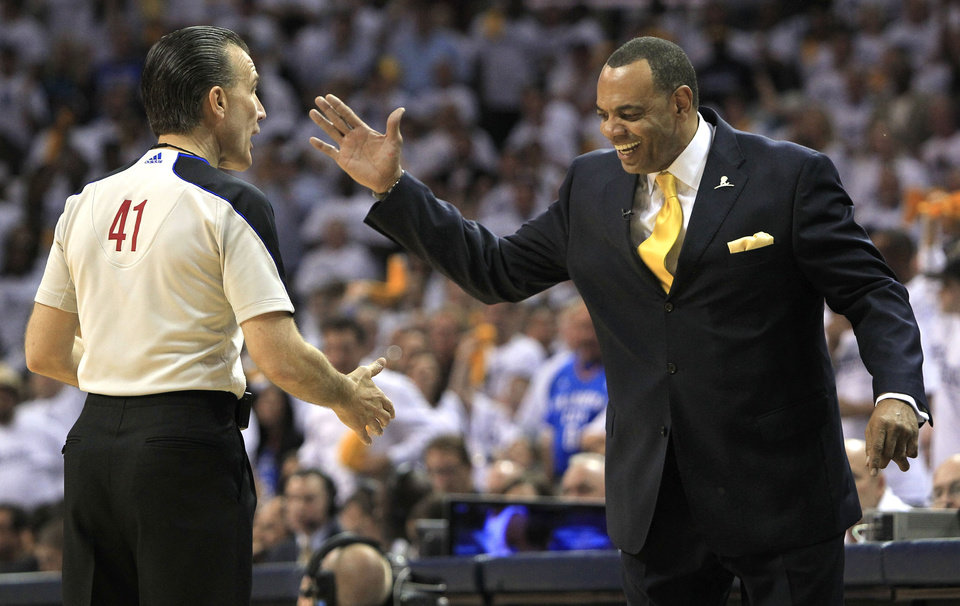 Photo - Memphis Grizzlies head coach Lionel Hollins, right, slaps hands with referee Ken Mauer (41) during the second half of Game 3 against the Oklahoma City Thunder in a second-round NBA basketball series on Saturday, May 7, 2011, in Memphis, Tenn. The Grizzlies won 101-93 in overtime to take a 2-1 lead in the series. (AP Photo/Mark Humphrey)