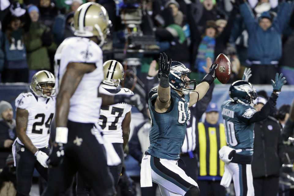 Photo - Philadelphia Eagles' Zach Ertz (86) celebrates after scoring a touchdown during the second half of an NFL wild-card playoff football game against the New Orleans Saints, Saturday, Jan. 4, 2014, in Philadelphia. (AP Photo/Matt Rourke)