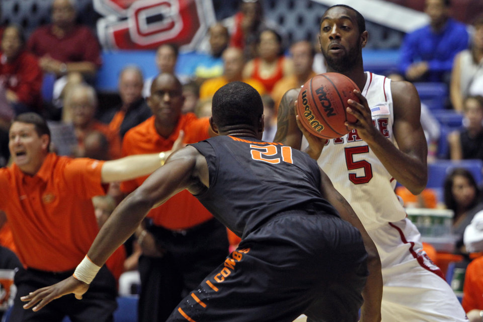 Photo - Oklahoma State's Kamari Murphy (21) pressures NC State's C.J. Leslie (5) during a NCAA college basketball game in Bayamon, Puerto Rico, Sunday, Nov. 18, 2012. (AP Photo/Ricardo Arduengo)