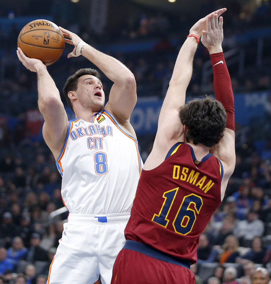 Photo - Oklahoma City's Danilo Gallinari (8) attempts a shot beside Cleveland's Cedi Osman (16) during an NBA basketball game between the Oklahoma City Thunder and the Cleveland Cavaliers at Chesapeake Energy Arena in Oklahoma City, Wednesday, Feb. 5, 2020. [Bryan Terry/The Oklahoman]