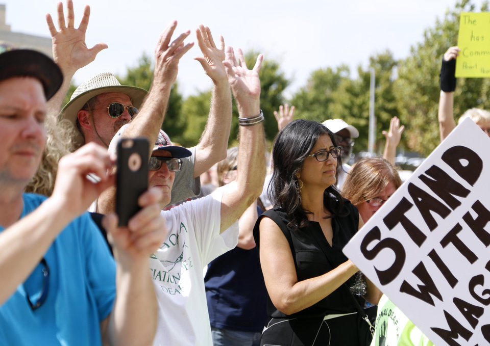 Photo - Deaf protestors applause during the Justice for Magdiel Sanchez rally in Oklahoma City, Sunday, Sept. 24, 2017. Photo by Sarah Phipps, The Oklahoman